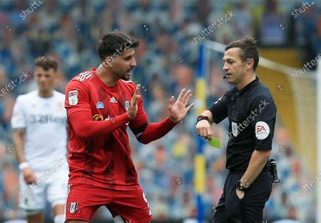 Aleksander Mitrovic of Fulham and Referee Mr Tony Harrington