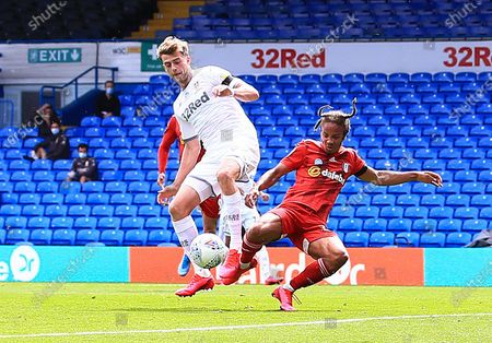 Fulham players appeal for a penalty kick after this challenge from Patrick Bamford of Leeds United on Bobby Reid