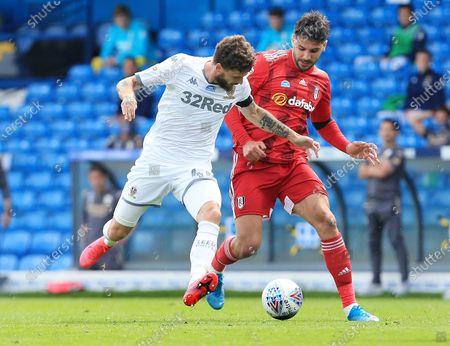 Aleksander Mitrovic of Fulham and Mateusz Klich of Leeds United