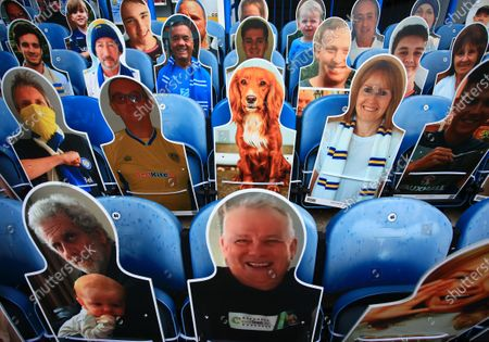 Cardboard cut outs of Leeds United fans including family dog