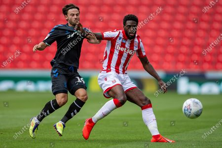 Bet365 Stadium, Stoke, Staffordshire, England; Bruno Martins Indi of Stoke City holds off Patrick Roberts of Middlesbrough; English Championship Football, Stoke City versus Middlesbrough.