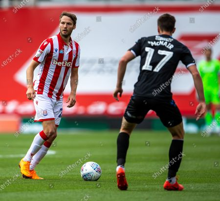 Bet365 Stadium, Stoke, Staffordshire, England; Nick Powell of Stoke City looks to cross the ball past Paddy McNair of Middlesbrough; English Championship Football, Stoke City versus Middlesbrough.