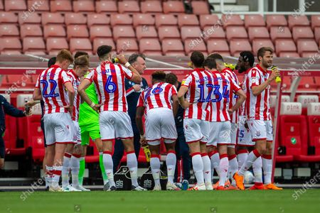 Bet365 Stadium, Stoke, Staffordshire, England; Stoke City Manager Michael O'Neill gives his players instructions during the water break; English Championship Football, Stoke City versus Middlesbrough.
