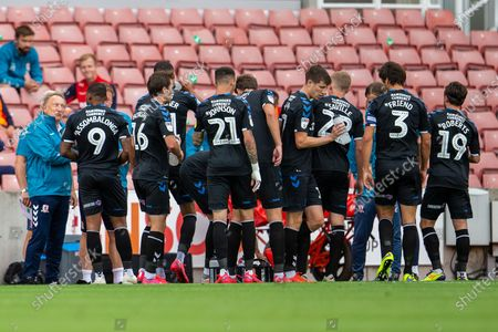 Bet365 Stadium, Stoke, Staffordshire, England; Newly appointed Middlesborough Manager Neil Warnock gives his players instructions during the water break; English Championship Football, Stoke City versus Middlesbrough.