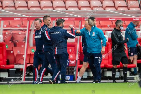 Bet365 Stadium, Stoke, Staffordshire, England; Newly appointed Middlesborough Manager Neil Warnock wrist bumbs the Stoke bench at the end of the match; English Championship Football, Stoke City versus Middlesbrough.