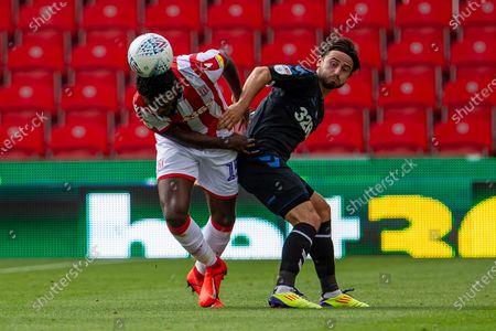 Bet365 Stadium, Stoke, Staffordshire, England; Bruno Martins Indi of Stoke City heads the ball away from danger; English Championship Football, Stoke City versus Middlesbrough.