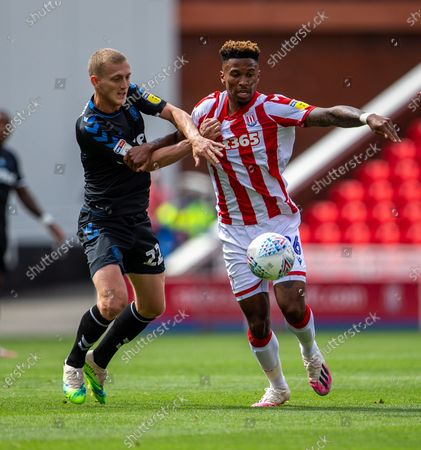 Bet365 Stadium, Stoke, Staffordshire, England; George Saville of Middlesbrough tackles Tyrese Campbell of Stoke City; English Championship Football, Stoke City versus Middlesbrough.