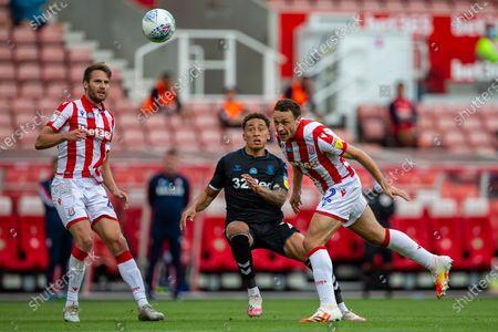 Bet365 Stadium, Stoke, Staffordshire, England; James Chester of Stoke City heads the ball back to Goalkeeper Jack Butland; English Championship Football, Stoke City versus Middlesbrough.