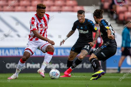 Bet365 Stadium, Stoke, Staffordshire, England; Tyrese Campbell of Stoke City under pressure from Marvin Johnson of Middlesbrough; English Championship Football, Stoke City versus Middlesbrough.