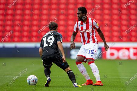 Bet365 Stadium, Stoke, Staffordshire, England; Bruno Martins Indi of Stoke City under pressure from Patrick Roberts of Middlesbrough; English Championship Football, Stoke City versus Middlesbrough.