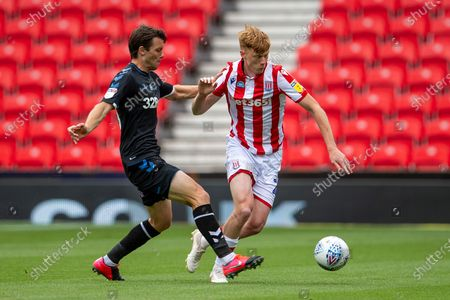 Bet365 Stadium, Stoke, Staffordshire, England; Badou Ndiaye of Stoke City is tackled by Jonny Howson of Middlesbrough; English Championship Football, Stoke City versus Middlesbrough.