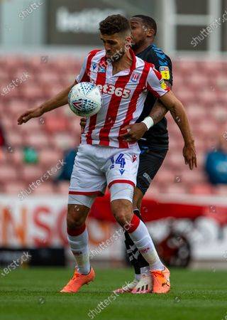 Bet365 Stadium, Stoke, Staffordshire, England; Tommy Smith is tackled by Patrick Roberts of Middlesbrough; English Championship Football, Stoke City versus Middlesbrough.