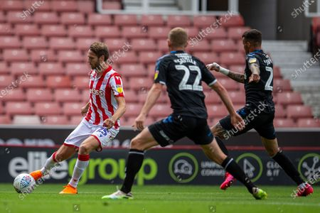 Bet365 Stadium, Stoke, Staffordshire, England; Nick Powell of Stoke City crosses the ball in front of George Saville of Middlesbrough; English Championship Football, Stoke City versus Middlesbrough.