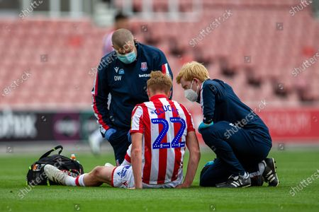 Bet365 Stadium, Stoke, Staffordshire, England; Sam Clucas of Stoke City receives treatement from Stoke medical staff in masks; English Championship Football, Stoke City versus Middlesbrough.