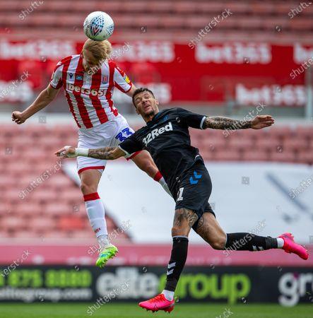 Bet365 Stadium, Stoke, Staffordshire, England; Lasse Sorensen of Stoke City climbs high to win the header; English Championship Football, Stoke City versus Middlesbrough.