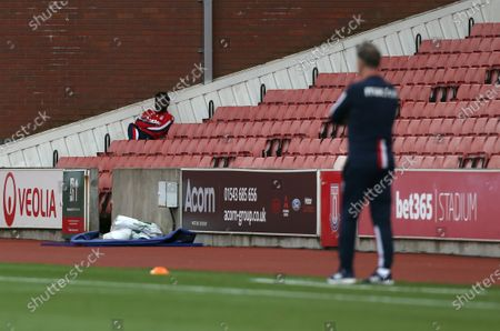 Stoke City's Mame Diouf watches the game on his own