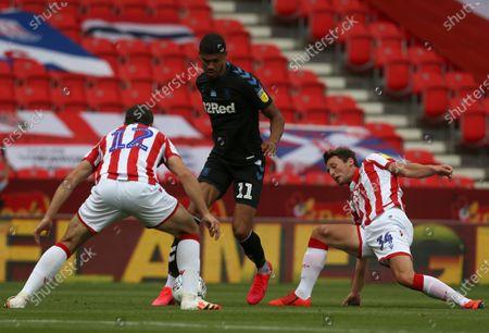 Middlesbrough's Ashley Fletcher takes on Stoke City's Jordan Thompson and  James Chester