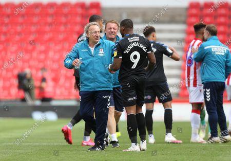 Stock Photo of Middlesbrough Manager, Neil Warnock celebrates victory with  Britt Assombalonga