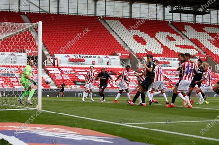 Stoke City's Jack Butland  watches as Middlesbrough's Ashley Fletcher heads the first goal