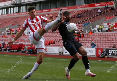 Stoke City's Danny Batth clears under pressure from Middlesbrough's Britt Assombalonga