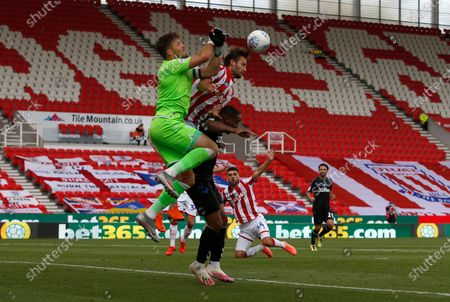 Stoke City's Jack Butland  struggles to hold onto the ball under pressure from Middlesbrough's Britt Assombalonga