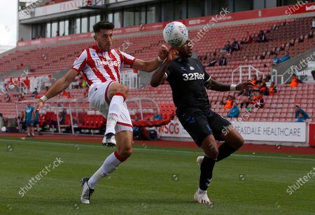 Stoke City's Danny Batth battles with Middlesbrough's Britt Assombalonga