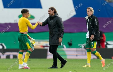 Norwich City Manager Daniel Farke bumps fists with a dejected Max Aarons of Norwich City