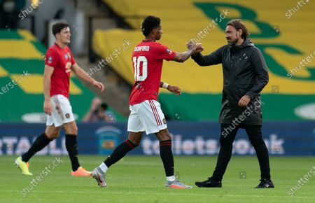 Norwich City Manager Daniel Farke bumps fists with Marcus Rashford of Manchester United at full-time
