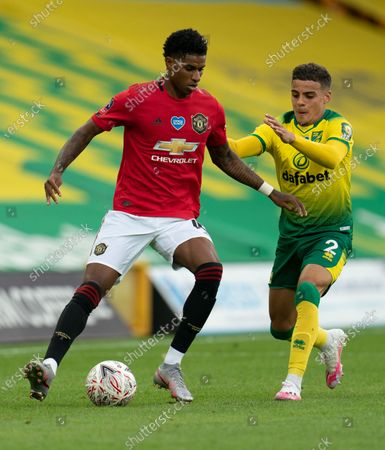 CAPTION CORReCTION: Marcus Rashford of Manchester United and Max Aarons of Norwich City