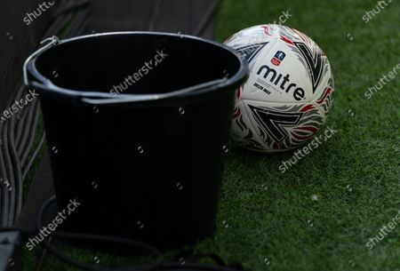 The Mitre matchball next to a wash bucket