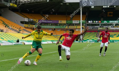 Jesse Lingard of Manchester United dives in to block Max Aarons of Norwich City