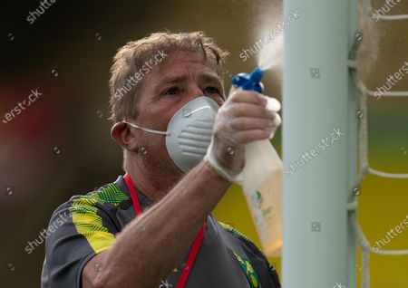 Norwich City Groundstaff wearing PPE / Face Masks disinfect the goalposts