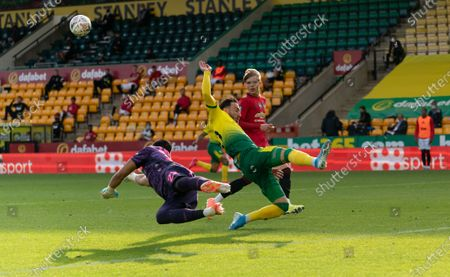 Josip Drmic of Norwich City dives for the ball past Manchester United Goalkeeper Sergio Romero