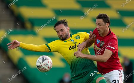 Josip Drmic of Norwich City and Nemanja Matic of Manchester United