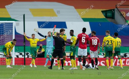Referee JOnathan Moss shows Timm Klose of Norwich City a red card