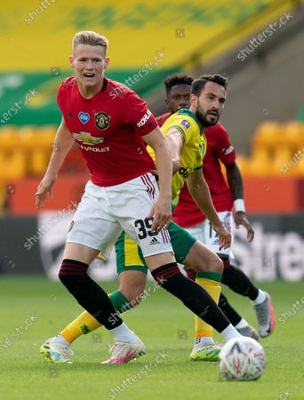 Scott McTominay of Manchester United and Lukas Rupp of Norwich City