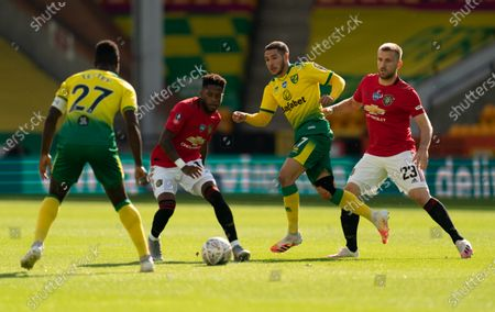 Fred of Manchester United is surrounded by Emiliano Buendia of Norwich City and Alexander Tettey of Norwich City