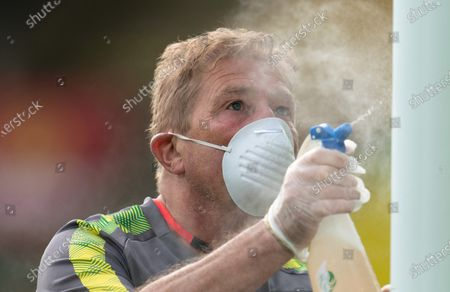 Norwich City groundstaff disinfect the goalposts