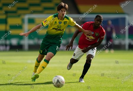 Timm Klose of Norwich City and Odion Ighalo of Manchester United