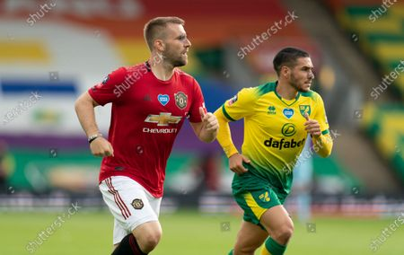 Luke Shaw of Manchester United and Emiliano Buendia of Norwich City