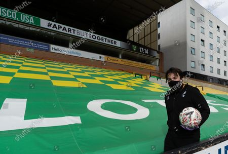 Norwich City staff wear PPE / Face Masks while returning the balls to play