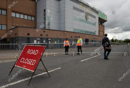 Media make their way to Carrow Road through the road blockade