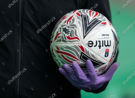 Staff weareing PPE / gloves return the ball to players