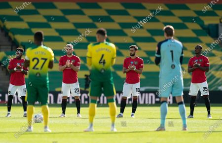 Norwich City and Manchester United pplayers applaud the NHS
