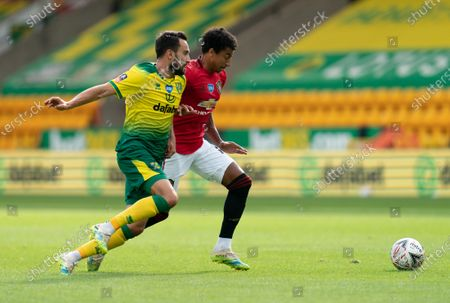 Lukas Rupp of Norwich City and Jesse Lingard of Manchester United
