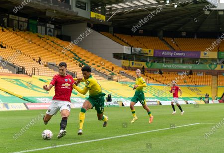 Diogo Dalot of Manchester United takes on Jamal Lewis of Norwich City
