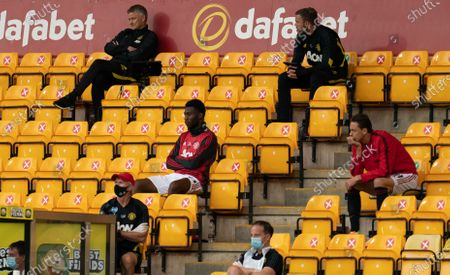 Manchester United Manager Ole Gunnar Solskjaer sits in the stands,, socially distanced from his players