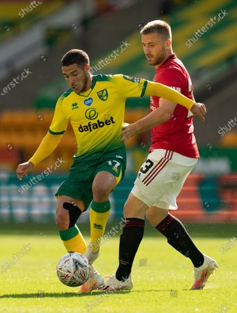 Emiliano Buendia of Norwich City and Luke Shaw of Manchester United