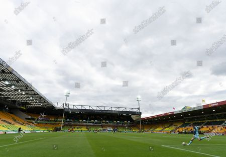 Norwich City Goalkeeper Tim Krul clears the ball inside an empty Carrow Road