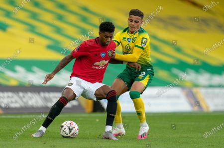 Marcus Rashford of Manchester United and Jamal Lewis of Norwich City